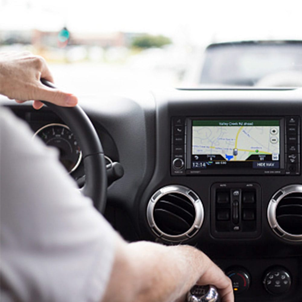 person driving car with navigation system