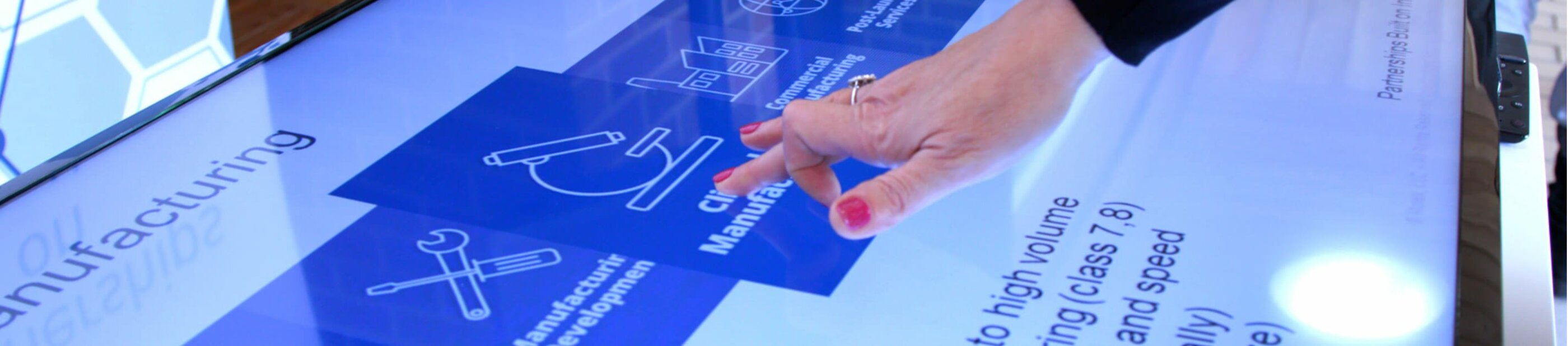 woman's hand interacting with data on a touch screen
