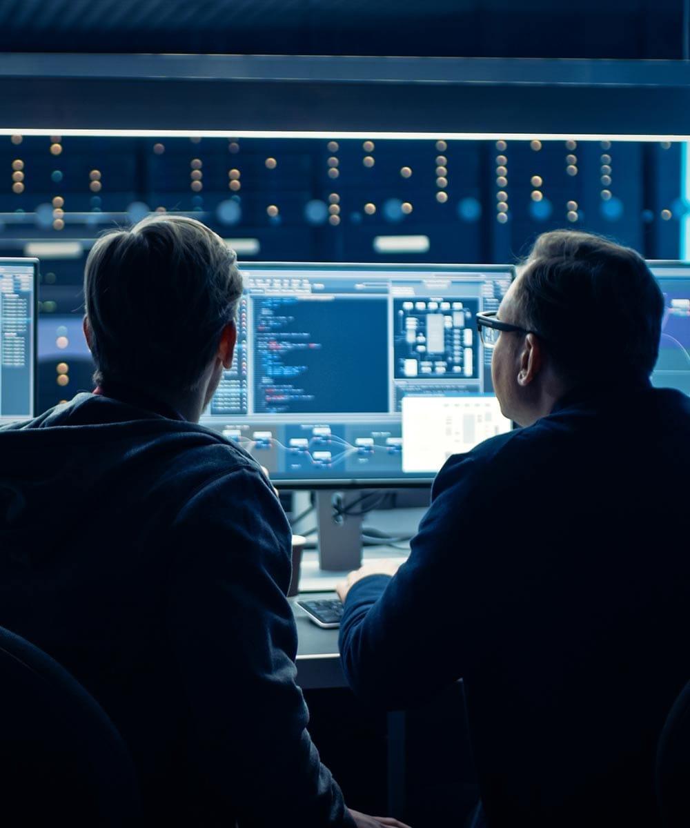 two men looking at computer screens
