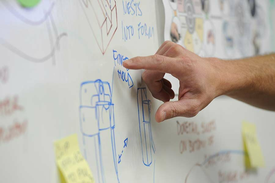 hand pointing to white board